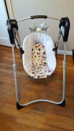 slim spaces compact baby swing etcher niob